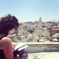 Reading her trusty Israel Footprint book in Jerusalem