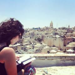 Reading her trusty Israel Footprint book in Jerusalem